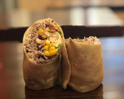 whole wheat burrito with rice, beans, corn, and chicken
