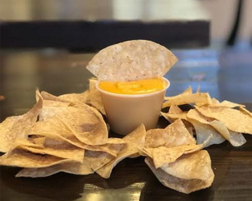 tortilla chips and nacho cheese